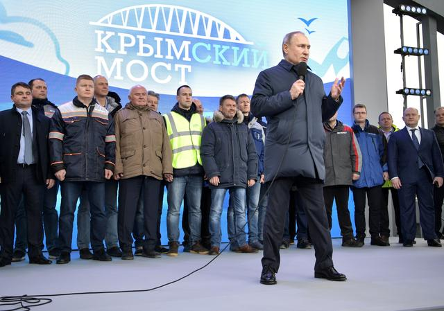 Russian President Vladimir Putin delivers a speech during the opening ceremony of the railway part of a bridge, which was constructed to connect the Russian mainland with the Crimean Peninsula across the Kerch Strait, in Taman, Russia December 23, 2019. Sputnik/Aleksey Nikolskyi/Kremlin via REUTERS