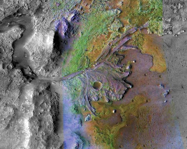 FILE PHOTO: Fans and deltas formed by water and sediment are seen in the Jezero Crater on Mars, identified as a potential landing site for the Mars 2020 Rover, in this false color image taken by NASA's Mars Reconnaissance Orbiter, published May 15, 2019 and obtained November 15, 2019. NASA/JPL-Caltech/Handout via REUTERS