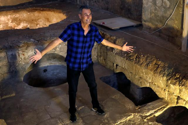 FILE PHOTO: Uri Geller gestures during an interview at the Uri Geller Museum in Jaffa, near Tel Aviv, Israel August 14, 2018.  REUTERS/Ronen Zvulun