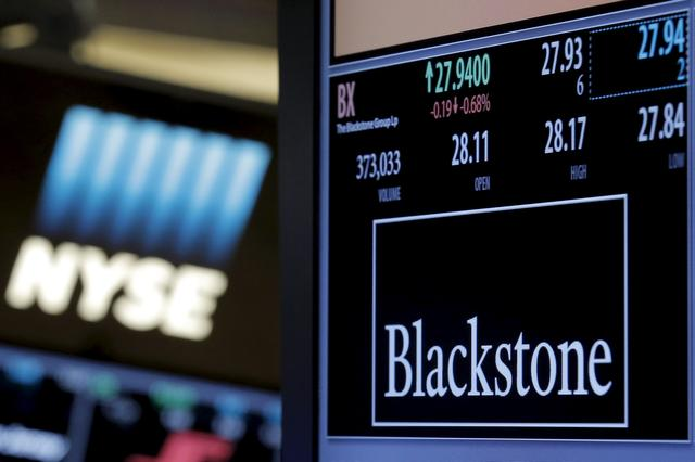 FILE PHOTO: The ticker and trading information for Blackstone Group is displayed at the post where it is traded on the floor of the New York Stock Exchange (NYSE) April 4, 2016. REUTERS/Brendan McDermid