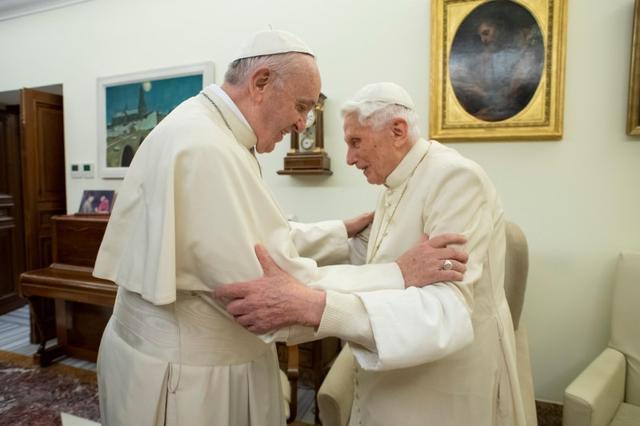 FILE PHOTO: Pope Francis visits his predecessor, Pope Emeritus Benedict XVI, at the Mater Ecclesiae Monastery in Vatican, December 21, 2018. Picture taken December 21, 2018.  Vatican Media/Handout via REUTERS/File Photo