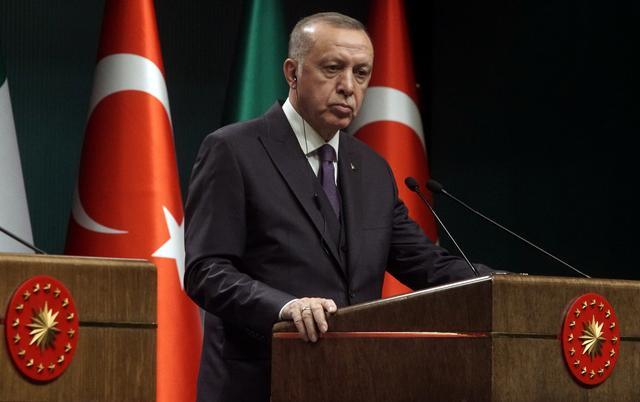 Turkish President Tayyip Erdogan reacts during a news conference in Ankara, Turkey January 13, 2020. REUTERS/Umit Bektas