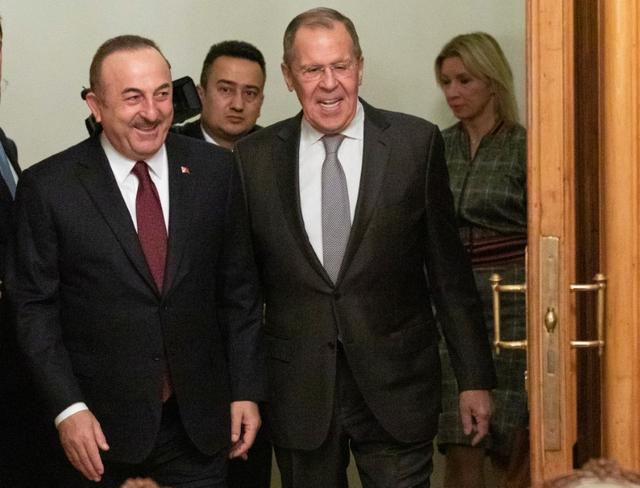Turkish Foreign Minister Mevlut Cavusoglu and Russian Foreign Minister Sergei Lavrov arrive for a meeting in Moscow, Russia January 13, 2020. Pavel Golovkin/Pool via REUTERS