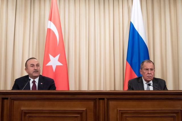 Turkish Foreign Minister Mevlut Cavusoglu and Russian Foreign Minister Sergei Lavrov attend a joint news conference following their talks in Moscow, Russia January 13, 2020. Pavel Golovkin/Pool via REUTERS