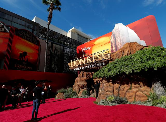 "FILE PHOTO: A person takes pictures ahead of the World Premiere of ""The Lion King"" in Los Angeles, California, U.S., July 9, 2019. REUTERS/Mario Anzuoni"