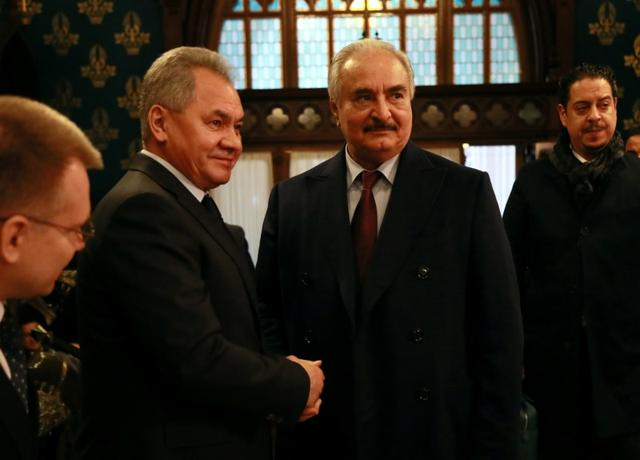 Commander of the Libyan National Army (LNA) Khalifa Haftar shakes hands with Russian Defence Minister Sergei Shoigu before talks in Moscow, Russia January 13, 2020. Ministry of Foreign Affairs of the Russian Federation/Handout via REUTERS