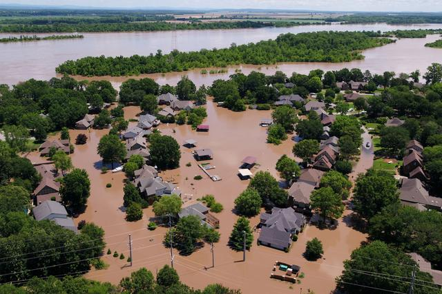 FILE PHOTO: A neighborhood engulfed in the flood waters of the Arkansas River is shown in this aerial photo in Fort Smith, Arkansas, U.S., May 30, 2019.  REUTERS/ Drone Base/File Photo