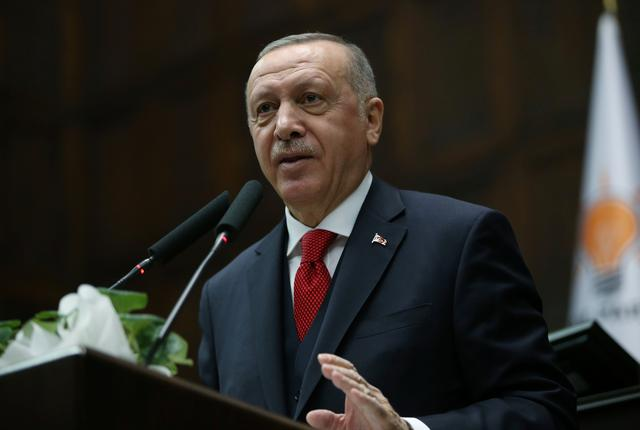 Turkish President Tayyip Erdogan addresses lawmakers from his ruling AK Party during a meeting at the parliament in Ankara, Turkey, January 14, 2020. Presidential Press Office/Handout via REUTERS