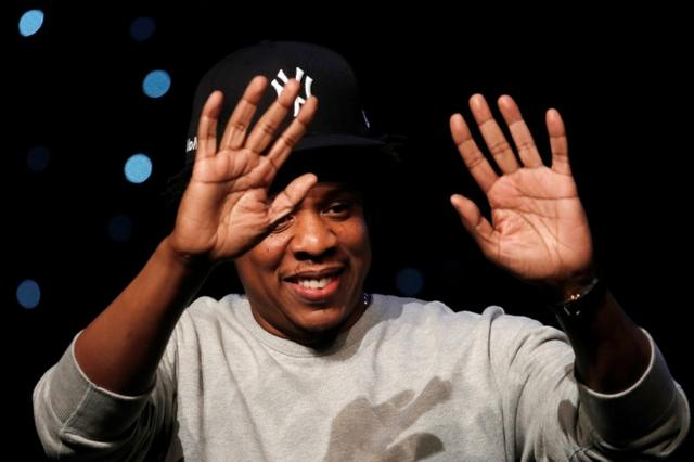 "FILE PHOTO: Shawn ""Jay-Z"" Carter, a founding partner of Reform Alliance, a newly formed organization to reform the U.S. criminal justice system, waves during the Reform Alliance launch event in New York City, New York., U.S., January 23, 2019. REUTERS/Mike Segar"
