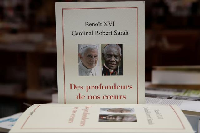 The book From the Depths of Our Hearts, co-written by retired pope Benedict XVI, is on display in a bookshop in Paris, France, January 15, 2020. REUTERS/Gonzalo Fuentes