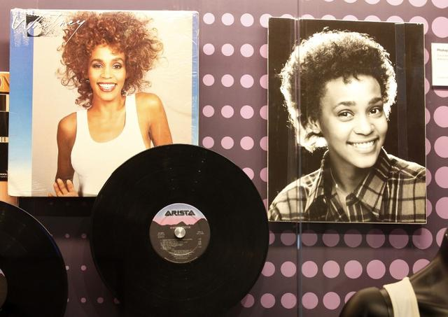 "FILE PHOTO: One of the Arista record label albums by late singer Whitney Houston  is pictured during a press preview of the new exhibit ""Whitney! Celebrating The Musical Legacy of Whitney Houston"", at The Grammy Museum in Los Angeles, California August 15, 2012. Grammy award winning singer Houston was found dead in a Beverly Hills hotel room on February 11, 2012. REUTERS/Fred Prouser"
