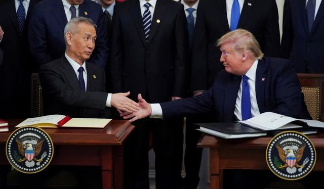 FILE PHOTO: Chinese Vice Premier Liu He and U.S. President Donald Trump shake hands after signing phase one of the U.S.-China trade agreement during a ceremony in the East Room of the White House in Washington, U.S., January 15, 2020. REUTERS/Kevin Lamarque