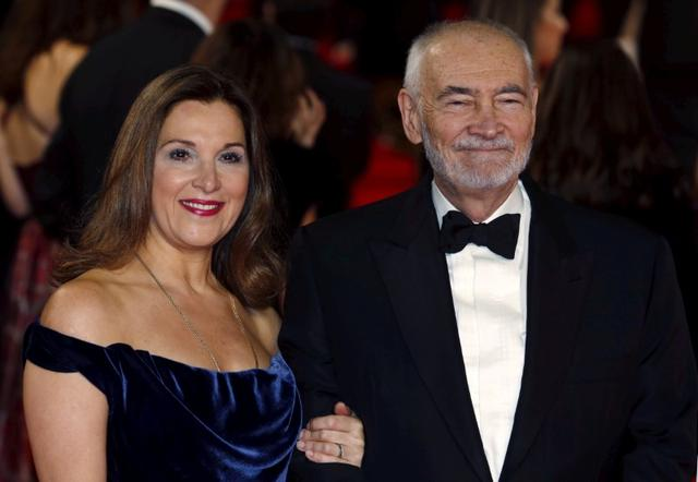 "FILE PHOTO: Producers Barbara Broccoli (L) and Michael G. Wilson pose for photographers on the red carpet at the world premiere of the new James Bond 007 film ""Spectre"" at the Royal Albert Hall in London, Britain, October 26, 2015. REUTERS/Luke MacGregor/File Photo"