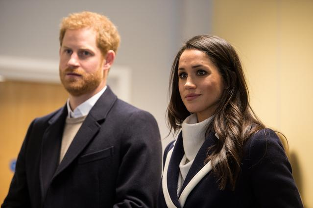 FILE PHOTO: Britain's Prince Harry and his fiancee Meghan Markle watch Coach Core apprentices taking part in a training masterclass exercise at Nechells Wellbeing Centre in Birmingham, Britain, March 8, 2018. REUTERS/Oli Scarff/Pool
