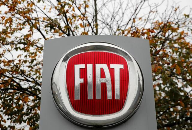 FILE PHOTO: The logo of car manufacturer Fiat is seen in Zurich, Switzerland October 30, 2019. REUTERS/Arnd Wiegmann/File Photo
