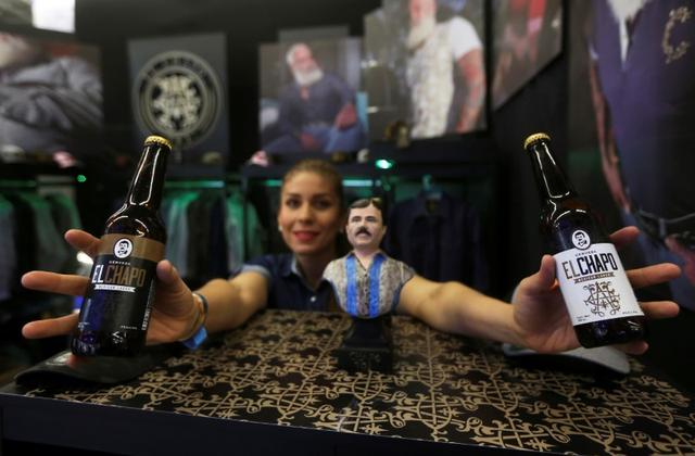 "A woman poses for a photo showing bottles of ""El Chapo"" beer, crafted by a company of Alejandrina Guzman, daughter of Mexican kingpin Joaquin ""El Chapo"" Guzman, at the Expo Guadalajara, in Guadalajara, Mexico January 17, 2020. REUTERS/Fernando Carranza"