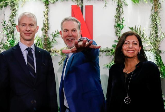French Culture Minister Franck Riester, Reed Hastings, co-founder and CEO of Netflix and Paris Mayor Anne Hidalgo attend the inauguration of Netflix new offices in Paris, France, January 17, 2020. REUTERS/Gonzalo Fuentes