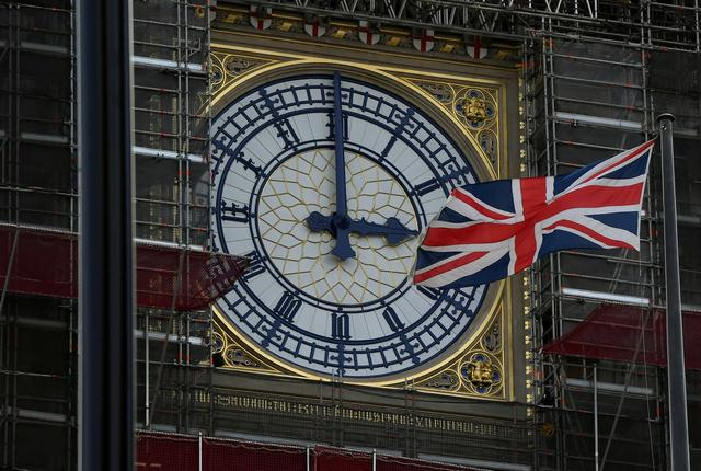 FILE PHOTO: British Union Jack Flies in front of the clock face of the tower that houses the Big Ben bell in London, Britain August 29, 2019. REUTERS/Toby Melville
