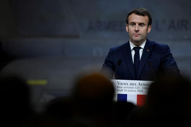 FILE PHOTO: French President Emmanuel Macron delivers his new year wishes to the military during a ceremony at the Orleans – Bricy Air Base 123 in Boulay-les-Barres near Orleans, France, January 16, 2020. Julien De Rosa/Pool via REUTERS