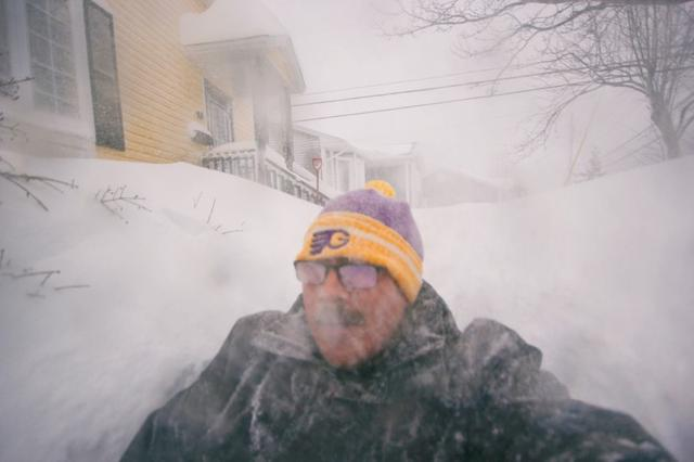 A man is pictured in a snowy street in St. John's, Newfoundland and Labrador, Canada January 17, 2020. Zach Bonnell/via REUTERS