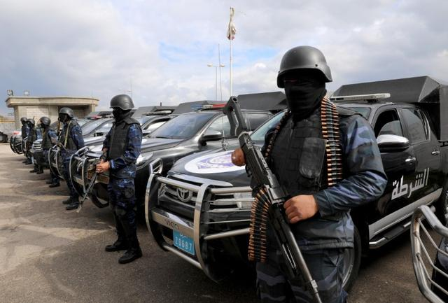 Central security support force carry weapons during the security deployment in the Tajura neighborhood, east of Tripoli, Libya January 14, 2020.  REUTERS/Ismail Zitouny
