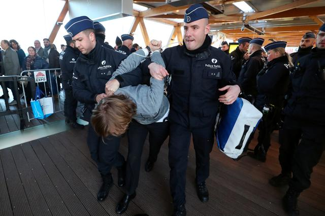 A demonstrator is carried away by police officers during a protest of the climate action group Extinction Rebellion at Brussels Motor Show in Brussels, Belgium January 18, 2020. REUTERS/Yves Herman