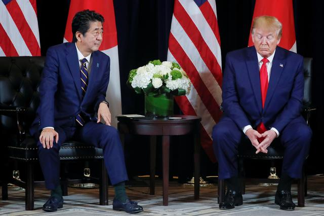 FILE PHOTO: U.S. President Donald Trump holds a bilateral meeting with Japan's Prime Minister Shinzo Abe on the sidelines of the 74th session of the United Nations General Assembly (UNGA) in New York City, New York, U.S., September 25, 2019.  REUTERS/Jonathan Ernst