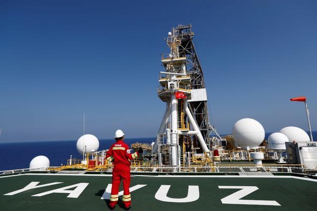FILE PHOTO: A Turkish Petroleum (TPAO) engineer poses on the helipad of Turkish drilling vessel Yavuz in the eastern Mediterranean Sea off Cyprus, August 6, 2019. REUTERS/Murad Sezer/File Photo