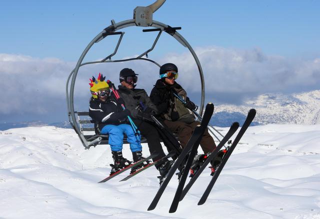 People ride a ski lift at Mzaar Ski Resort in Kfardebian, Lebanon January 11, 2020. REUTERS/Aziz Taher