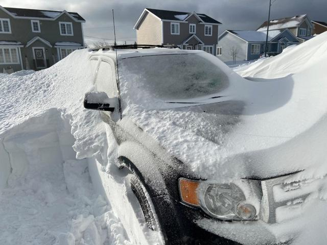 Pile of snow is pictured outside a house in St John's, Newfoundland And Labrador, Canada January 18, 2020 in this picture obtained from social media. J. David Mitchell/via REUTERS