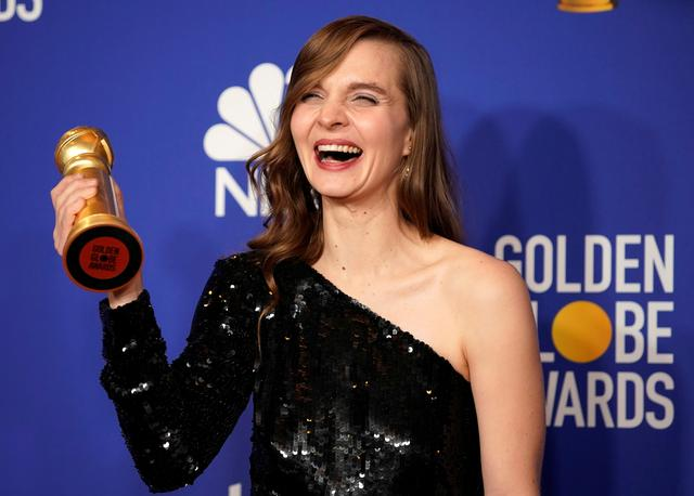 "FILE PHOTO: 77th Golden Globe Awards - Photo Room - Beverly Hills, California, U.S., January 5, 2020 - Hildur Guonadottir poses backstage with her Best Original Score - Motion Picture award for ""Joker."" REUTERS/Mike Blake/File Photo"