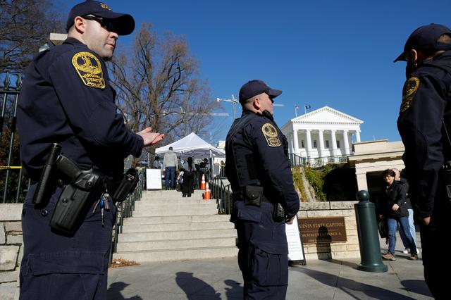 Police stand guard near an entrance to the Virginia State Capitol grounds before a Monday rally by gun rights advocates and militia members in Richmond, Virginia, U.S. January 19, 2020.  REUTERS/Jonathan Drake