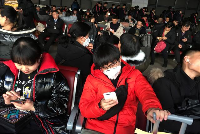 Passengers wearing masks are seen at the waiting area for a train to Wuhan at the Beijing West Railway Station, ahead of the Chinese Lunar New Year, in Beijing, China January 20, 2020. REUTERS/Stringer