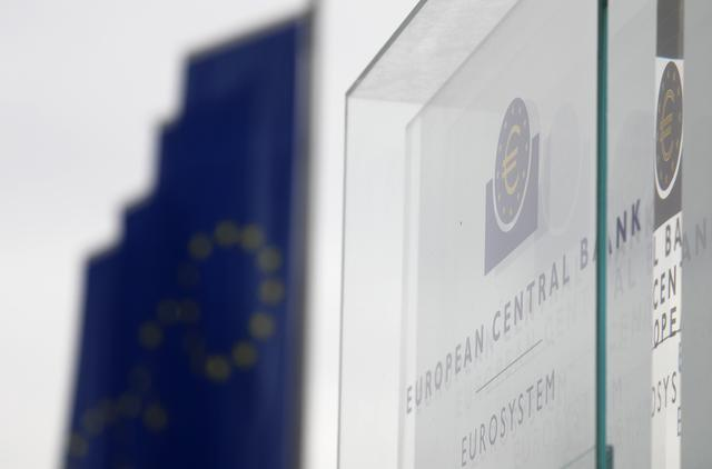 FILE PHOTO: A logo plate is seen at the entrance to the European Central Bank (ECB) headquarters in Frankfurt, Germany, October 26, 2017. REUTERS/Kai Pfaffenbach