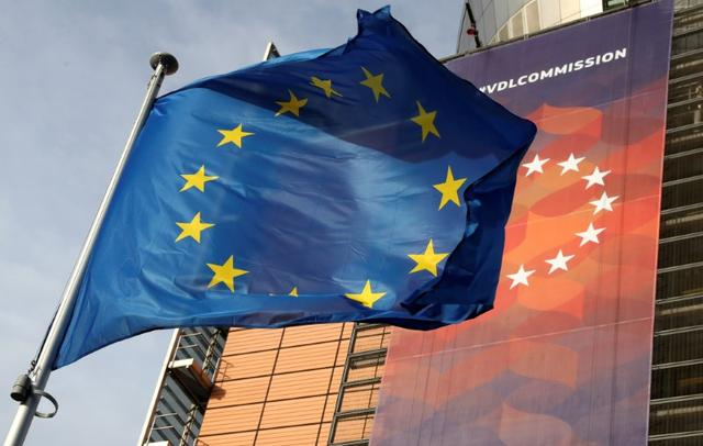 FILE PHOTO: A European Union flag flies outside the European Commission headquarters in Brussels, Belgium, December 19, 2019. REUTERS/Yves Herman