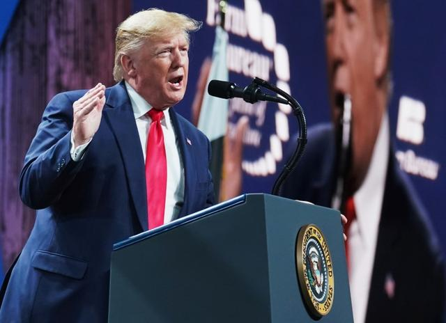 FILE PHOTO: U.S. President Donald Trump speaks at the American Farm Bureau Federation's Annual Convention and Trade Show in Austin, Texas, January 19, 2020. REUTERS/Kevin Lamarque