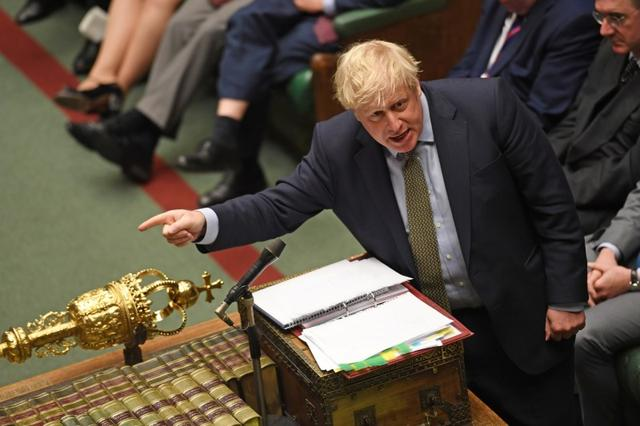 FILE PHOTO: Britain's Prime Minister Boris Johnson reacts during a Prime Minister's Questions session in the House of Commons, in London, Britain January 15, 2020. ©UK Parliament/Jessica Taylor/Handout via REUTERS