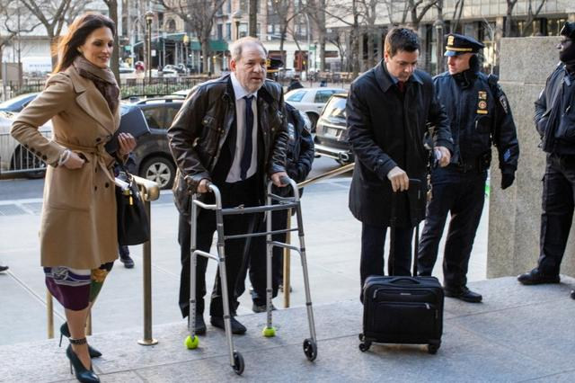 FILE PHOTO: Film producer Harvey Weinstein arrives at New York Criminal Court with his attorney Donna Rotunno for his sexual assault trial in the Manhattan borough of New York City, New York, U.S., January 17, 2020. REUTERS/Eduardo Munoz