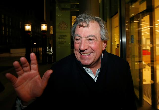 FILE PHOTO: British comedian Terry Jones smiles as he leaves The Rolls Building in central London November 30, 2012.  REUTERS/Suzanne Plunkett//File Photo