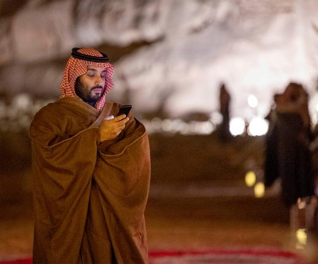 FILE PHOTO: Saudi Arabia's Crown Prince Mohammed bin Salman uses his phone during a meeting with Japan's Prime Minister Shinzo Abe in Riyadh, Saudi Arabia January 12, 2020.  Bandar Algaloud/Courtesy of Saudi Royal Court/Handout via REUTERS/File Photo