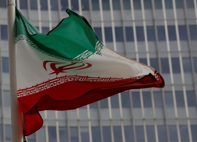 FILE PHOTO: An Iranian flag flutters in front of the International Atomic Energy Agency (IAEA) headquarters in Vienna, Austria September 9, 2019.   REUTERS/Leonhard Foeger/File Photo