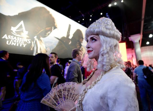 "FILE PHOTO: A woman dressed as Marie Antoinette from the video game ""Assassin's Creed: Unity"" promotes the game in the Ubisoft booth at the 2014 Electronic Entertainment Expo, known as E3, in Los Angeles, California June 10, 2014. REUTERS/Kevork Djansezian"