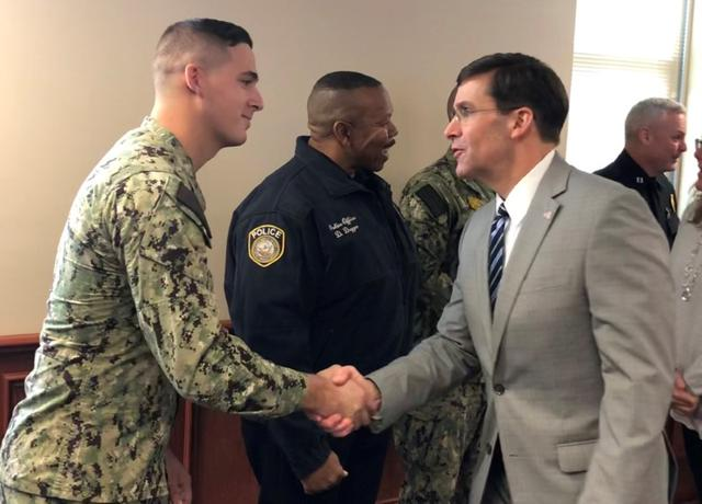 U.S. Defense Secretary Mark Esper meets Navy sailor David Link, one of the first responders at the scene of a December 6, 2019 shooting at Naval Air Station Pensacola by a Saudi military officer that killed three U.S. sailors, at the base in Pensacola, Florida, U.S., January 22, 2020. REUTERS/Phil Stewart