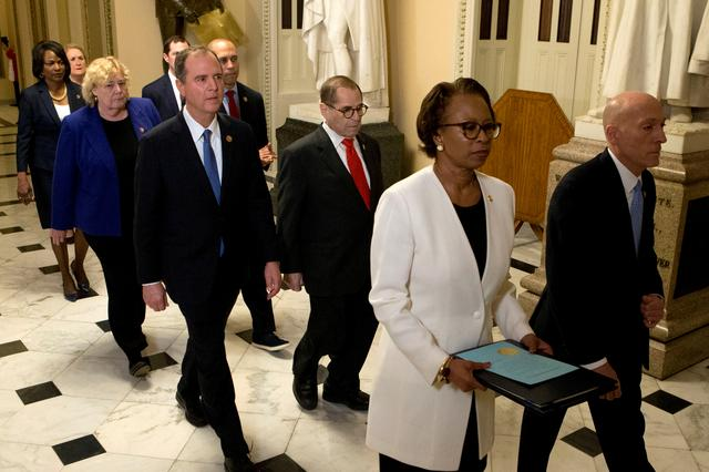 FILE PHOTO: House Sergeant at Arms Paul Irving and Clerk of the House Cheryl Johnson deliver the articles of impeachment against President Donald Trump to Secretary of the Senate Julie Adams on Capitol Hill in Washington, January 15, 2020. Following are impeachment managers, House Judiciary Committee Chairman, Rep. Jerrold Nadler, D-N.Y., House Intelligence Committee Chairman Adam Schiff, D-CA, Rep. Hakeem Jeffries, D-N.Y., Rep. Sylvia Garcia, D-TX, Rep. Val Demings, D-FL., Rep. Zoe Lofgren, D-CA, and Rep. Jason Crow, D-CO. Jose Luis Magana/ Pool via REUTERS/File Photo