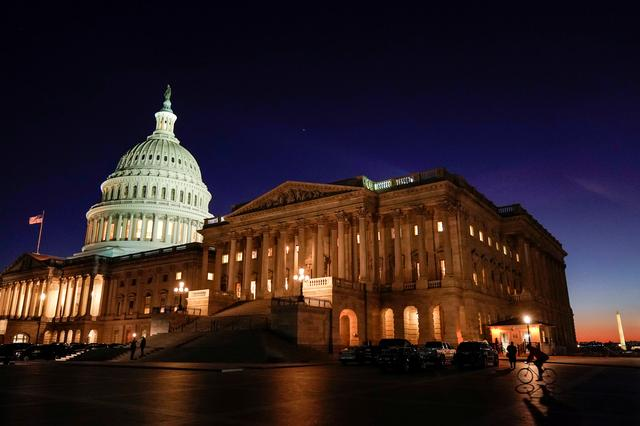 FILE PHOTO: The U.S. Capitol stands as evening falls on the first day of the impeachment trial of U.S. President Donald Trump in Washington, U.S., January 21, 2020.      REUTERS/Joshua Roberts/File Photo