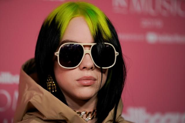 "FILE PHOTO: American singer-songwriter Billie Eilish arrives on the red carpet for the ""Billboard Women in Music"" event in Los Angeles, California, U.S. December 12, 2019.  REUTERS/Mike Blake"