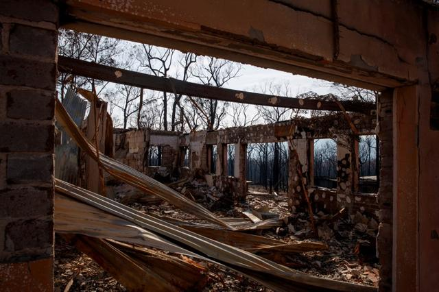 A destroyed building is seen at the Kangaroo Valley Bush Retreat after a wildfire raged through the property in Kangaroo Valley, New South Wales, Australia, January 23, 2020. REUTERS/Thomas Peter