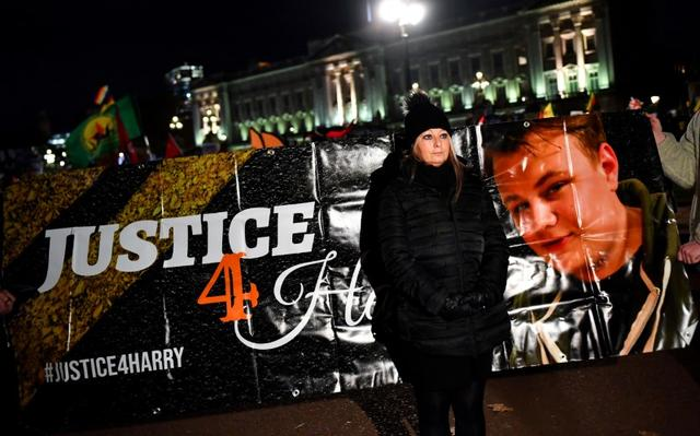 FILE PHOTO: Harry Dunn's mother Charlotte Charles poses in front of a banner outside the Buckingham Palace as people demonstrate during U.S. President Donald Trump's visit for NATO summit, in London, Britain December 3, 2019. REUTERS/Dylan Martinez/File Photo