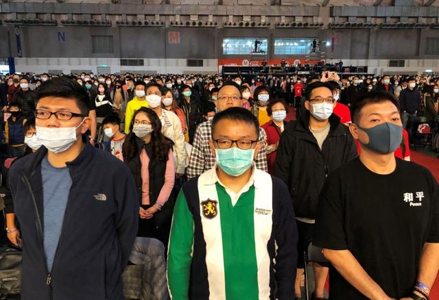 FILE PHOTO: Foxconn employees wearing masks attend the company's year-end gala in Taipei, Taiwan January 22, 2020. REUTERS/Yimou Lee