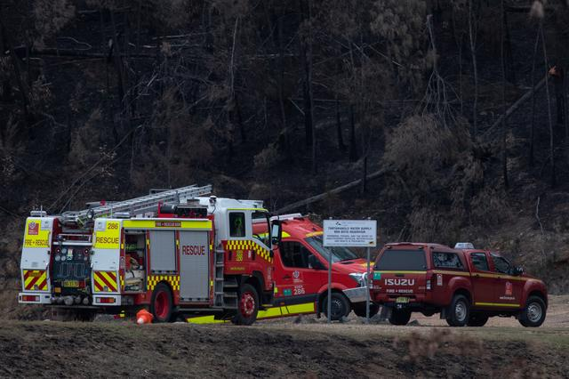 Fire rescue vehicles are seen at the Ben Boyd Reservoir following the crash of a firefighting helicopter, near Boyd Town, Australia January 9, 2020. REUTERS/Alkis Konstantinidis